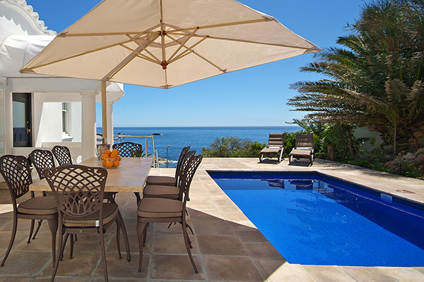 Villa pool deck with alfresco dining